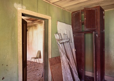 1421 Green chair in abandoned house, Texas Hill Country