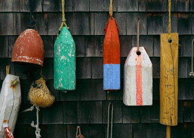 497 Lobster buoys on building, Rockport, Maine