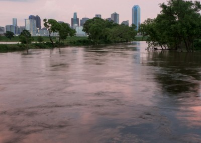 1100500 Trinity River flooding, downtown Dallas, Texas, dusk