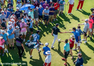 02474 Jordan Spieth fist-bumping fans during the 2018 AT&T Byron Nelson tournament at Trinity Forest Golf Club, Dallas, TX