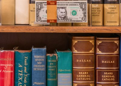 02565 LBJ's face on one dollar bills, on the shelf of his office at the LBJ Ranch, Stonewall, Texas