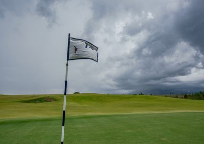 08653 4th hole flag blowing in wind, storm approaching, Trinity Forest Golf Club, Dallas, TX