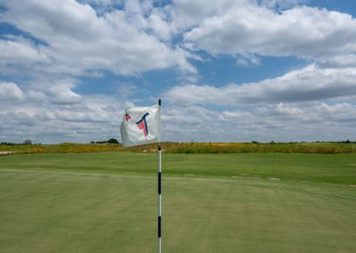 00642 Flag flapping in wind, 4th hole, Trinity Forest Golf Club, Dallas, TX